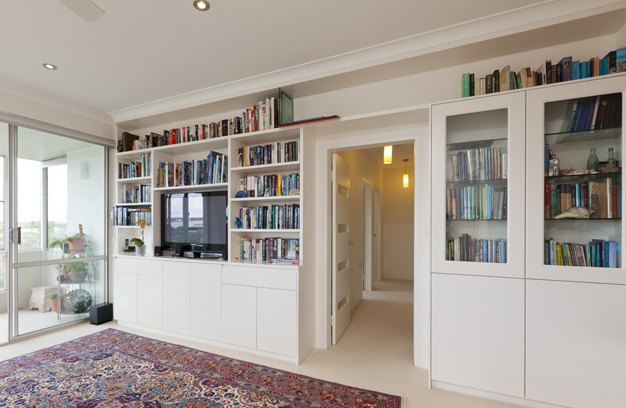 Custom built cabinet with over door wall unit