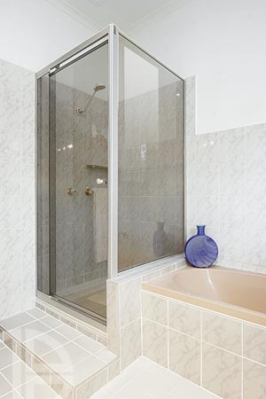 Semi frameless shower screen, pivot door system
