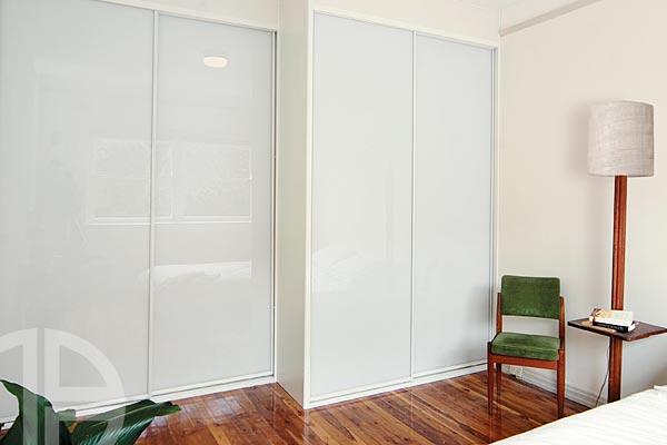 Framed white glass sliding doors